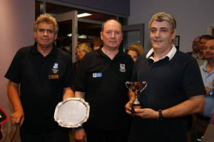 Lol collects his shield and trophy from Bill Sunderland.